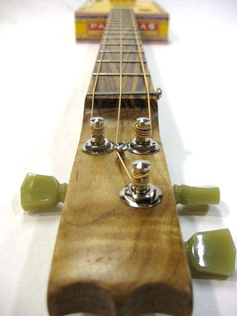how to play a three string cigar box guitar