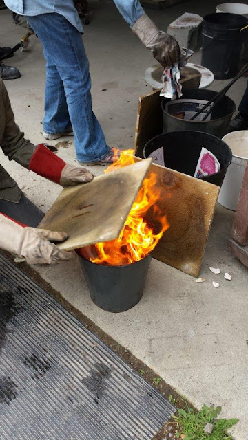Naked raku process - placing the pottery in a can with combustibles.