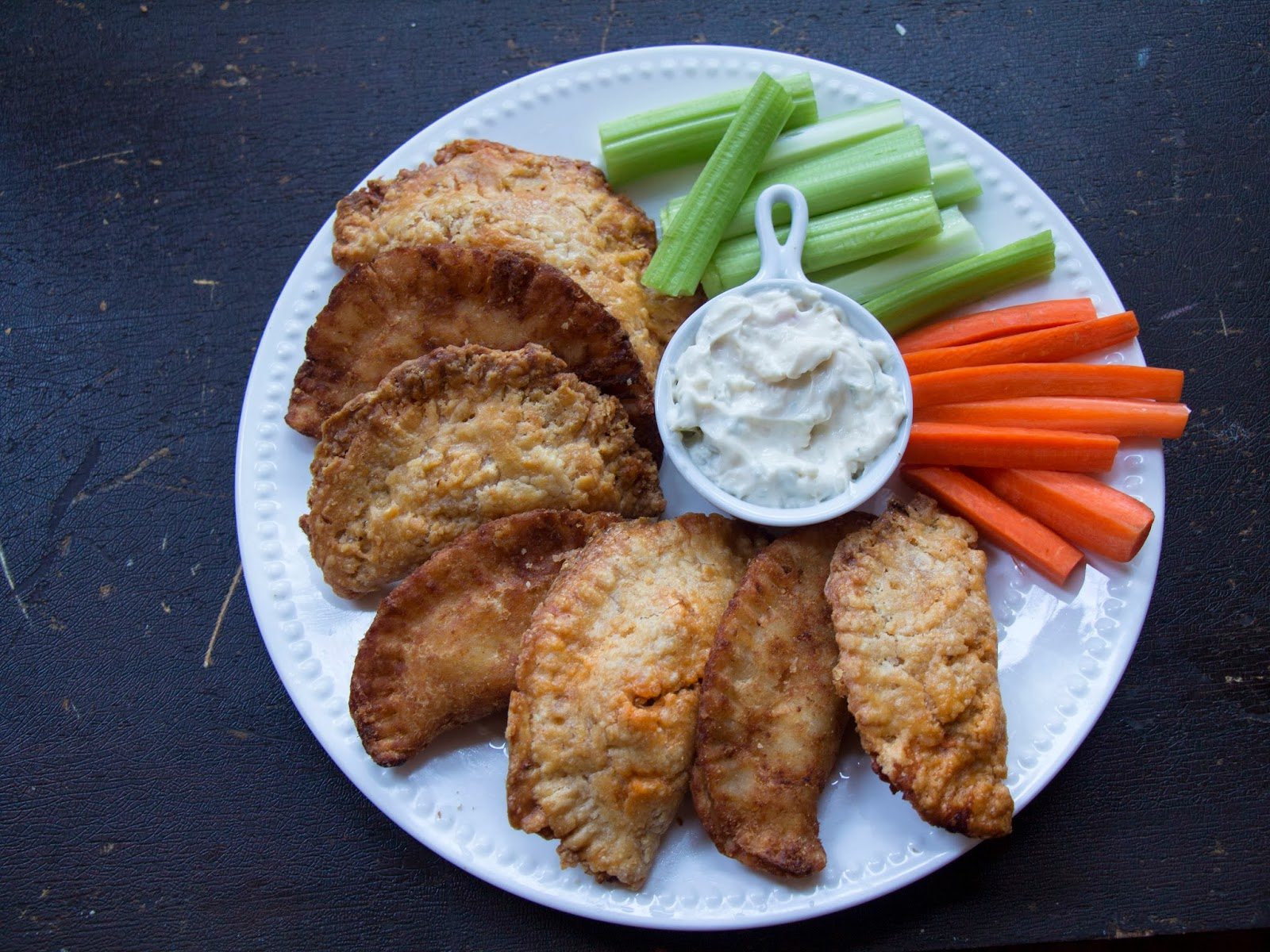 Buffalo Chicken Fried Pies on a Plate with Celery and Carrots