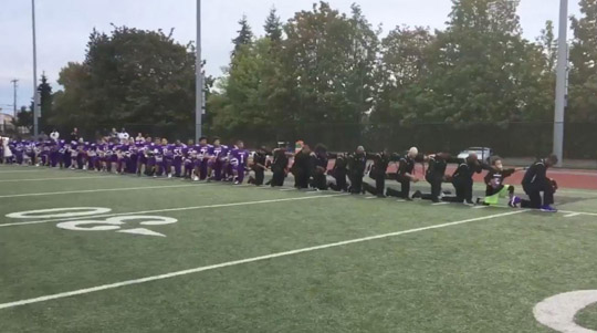 An entire high school team and coaches turn backs on our flag
