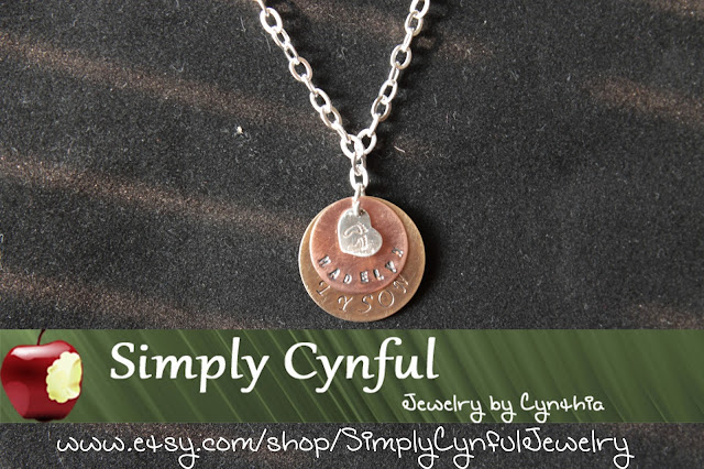 Mixed metal necklace stamped with names and baby feet