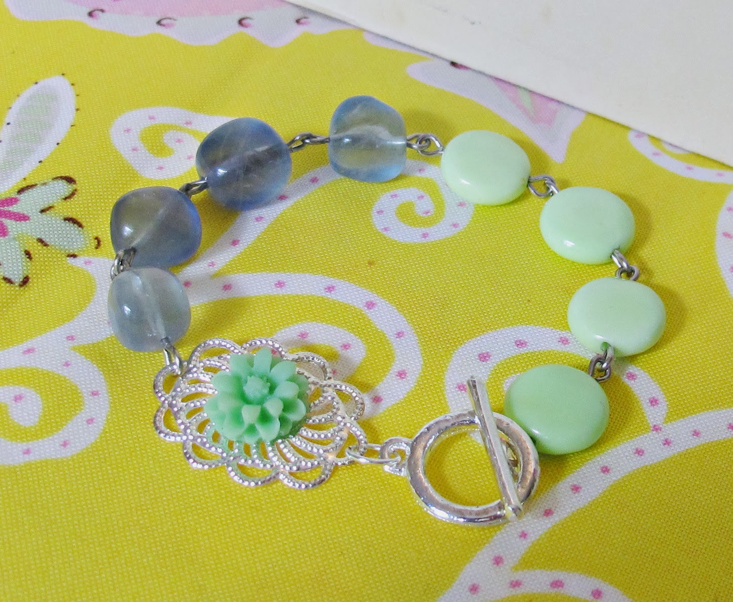 image meloi bracelet asymmetrical asymmetry cabochon flower silver chrysoprase blue agate two cheeky monkeys jewellery