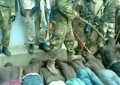 Nigerian soldier abusing captives. (Screen capture from video)