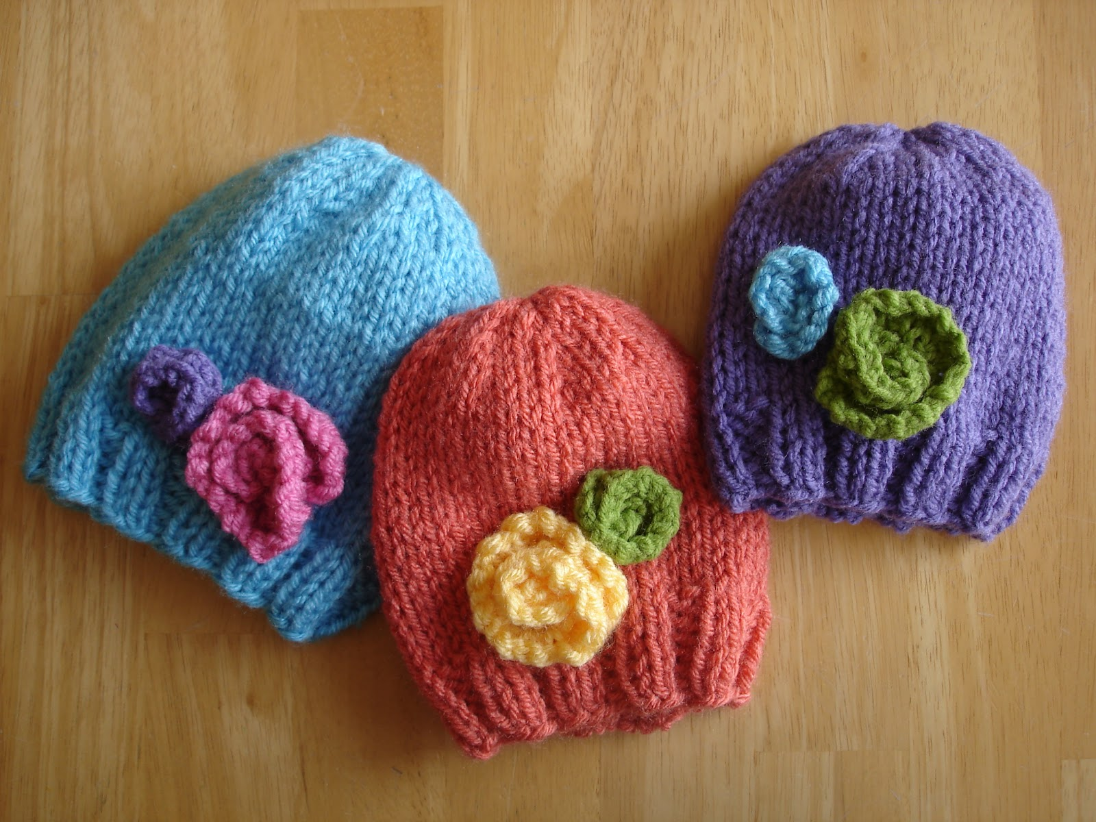 Knitted Baby Beanies Free Patterns : Fiber Flux: Free Knitting Pattern! Baby In Bloom Hats