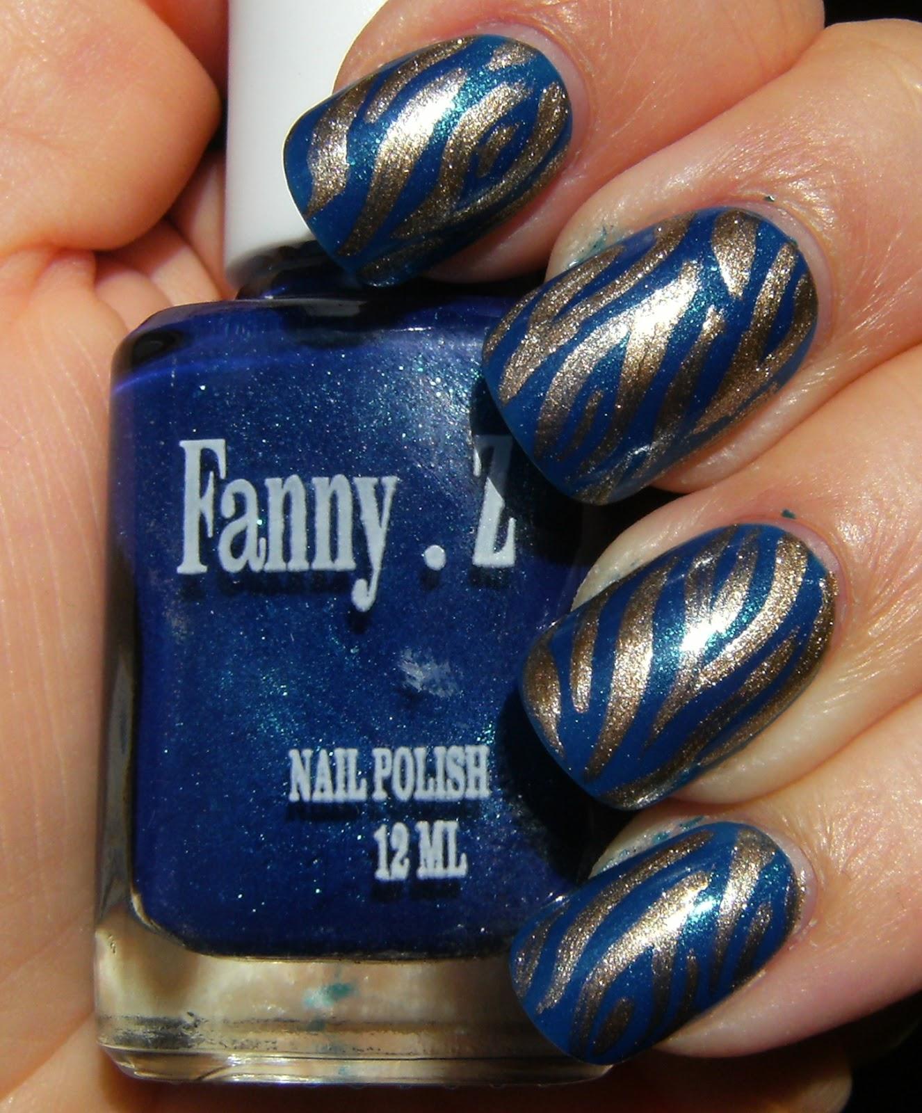 http://1.bp.blogspot.com/-0vjd5_17wso/UVN-hmflc1I/AAAAAAAAc-I/l3pXT9BCEcA/s1600/fanny+Z+%27whoa%27+with+gold+zebra+stripes+---DEEZ-NAILZ---+(10).JPG