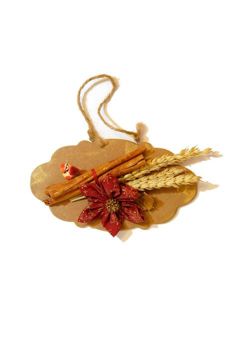 Decoro natalizio con fiore di stoffa e ...