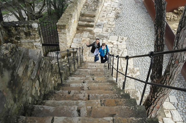 Us climbing Saint George's Castle or, Castle of São Jorge