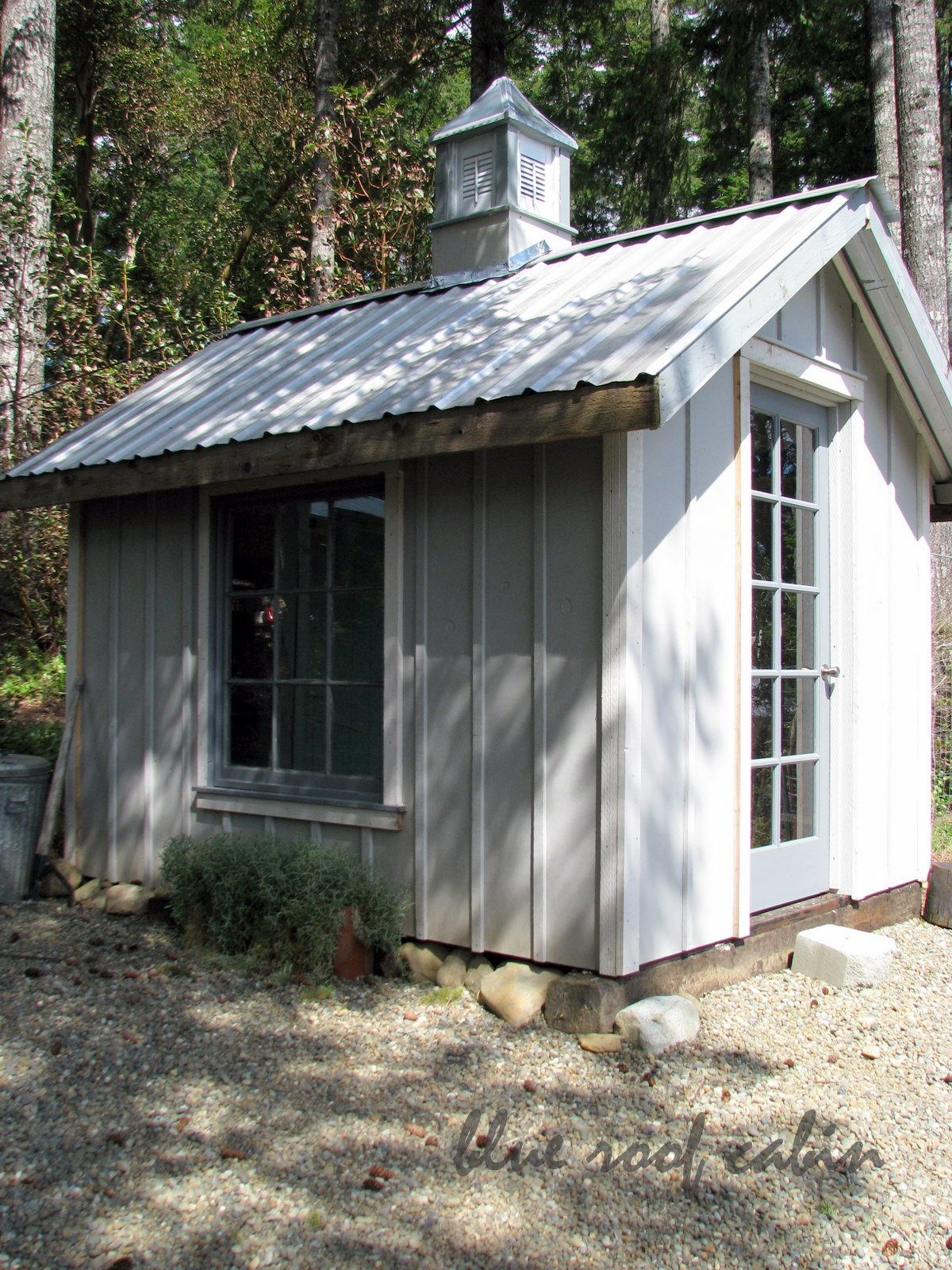 Blue roof cabin the potting shed for Shed roof cabin