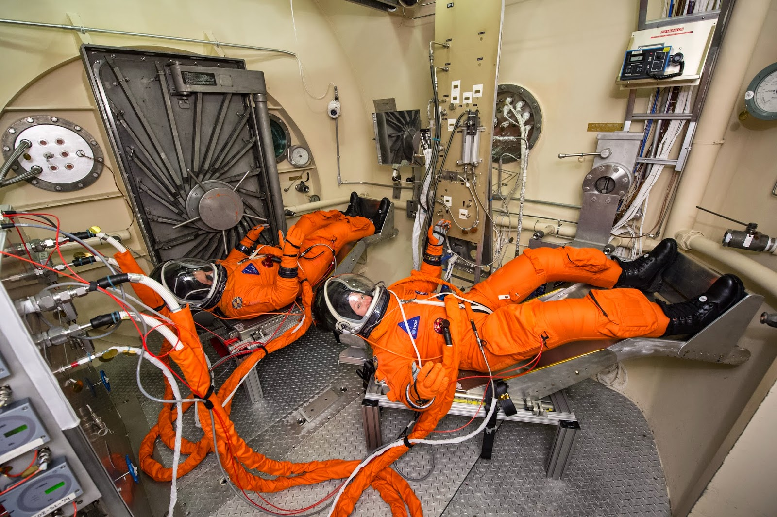 physics buzz going to mars how will we get there and who should go astronaut spacesuit testing for the orion spacecraft credit nasa bill stafford