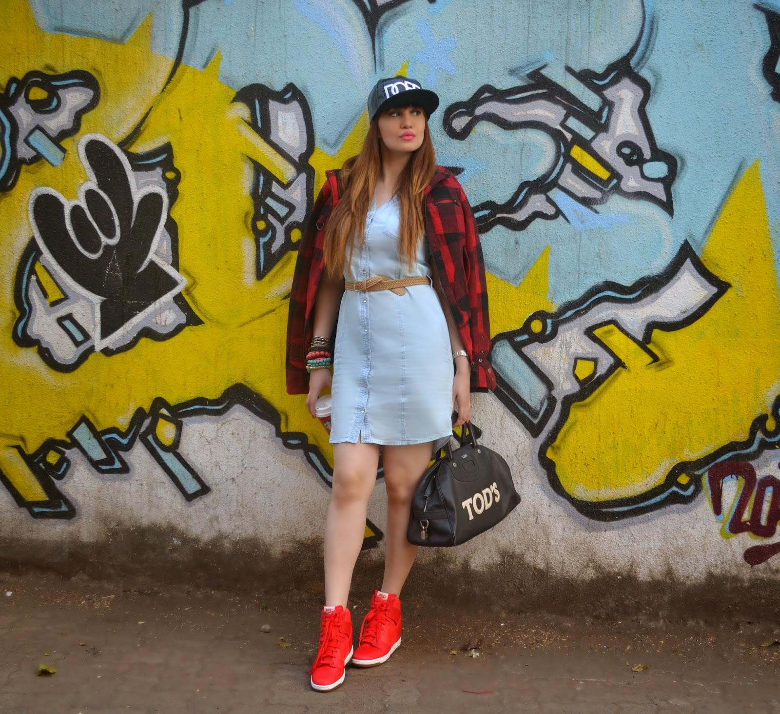 Plaid Jacket worn over a denim dress and Nike Dunk Sky Hi