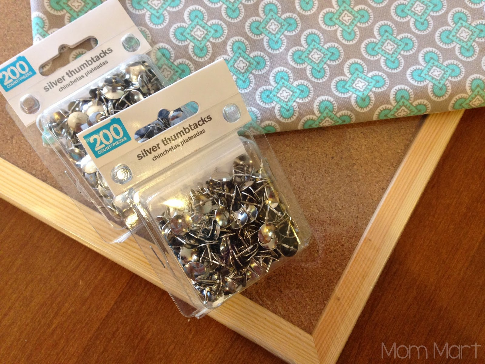 DIY fabric covered cork board with a faux nail head trim #DIY #HomeDecor #WeekendProject