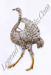 """This rhodium-plated pin, signed """"Coro"""", is mostly covered in rhinestones but has hand-painted highlights on the legs, beak, and eye, and is typical of Coro's humorous themes common in the 1930s and '40s. The enamelling and stone setting are of very high quality. Late 1930s. £275-375 ($470-64o)"""