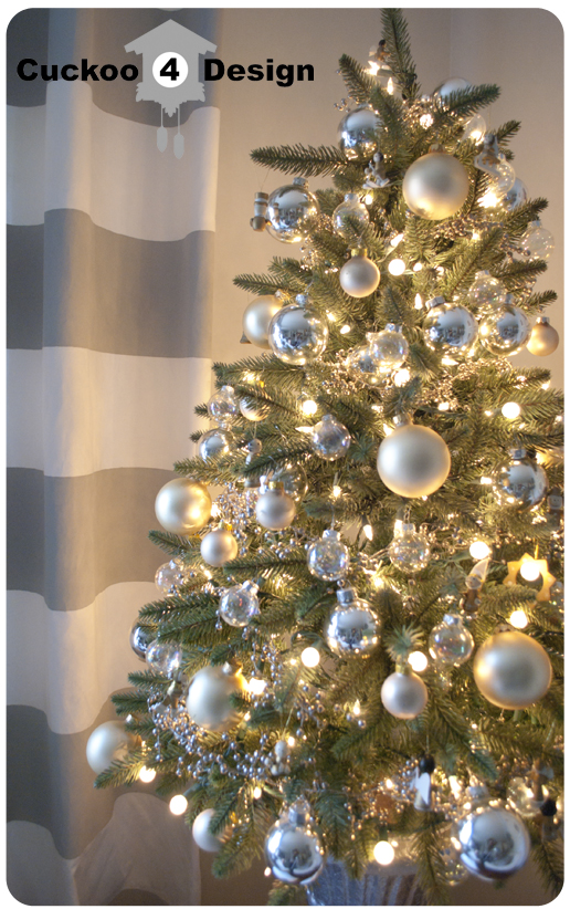 Small Christmas tree with silver, white and gold decorations