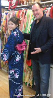 Young girl wearing a Kimono with proud father