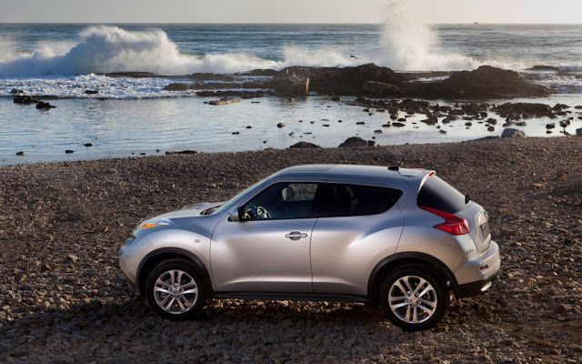 Silver Nissan Juke at the seashore,side profile