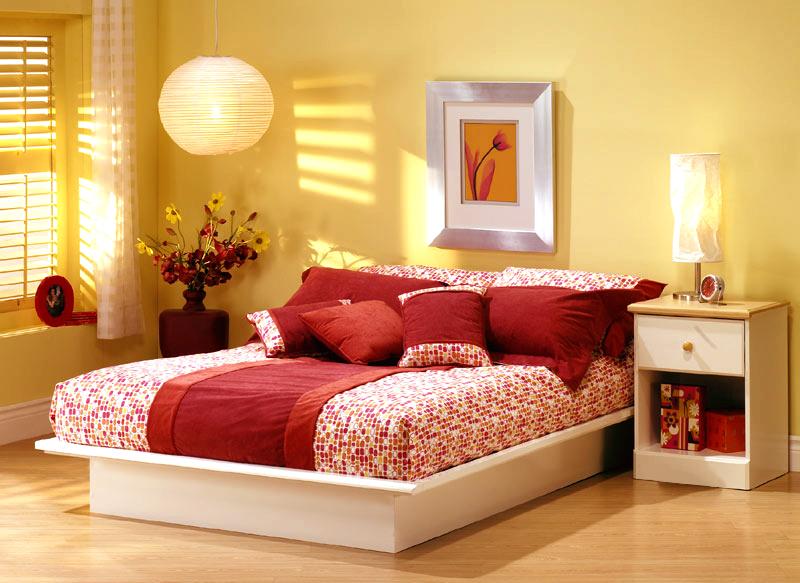 una cama francesa dormitorios con estilo