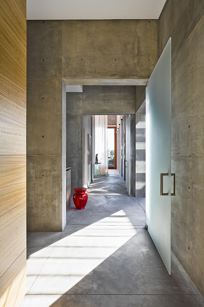 Hallway in Concrete House by Shubin + Donaldson Architects