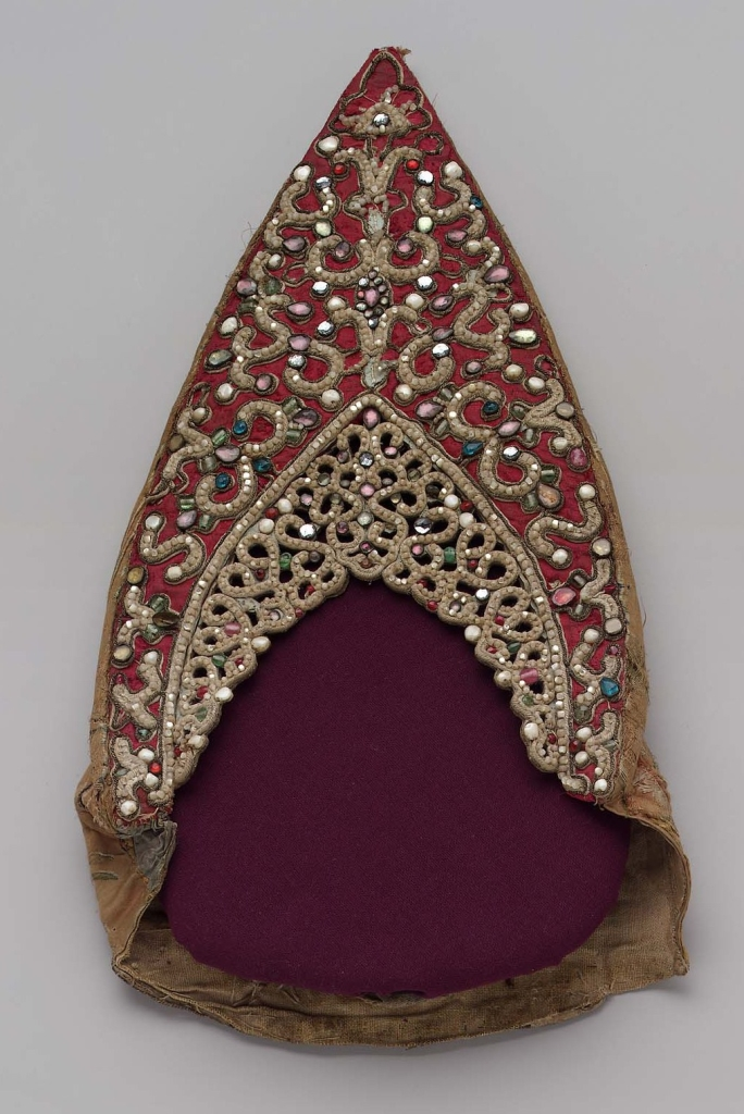 Traditional head wear made from silk and decorated with silver thread, glass beads and coloured glass
