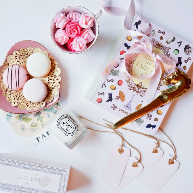 Sugar pink roses, pink pastel macarons, heart shaped plate, roses by diptyque Paris, and Laduree Almanac