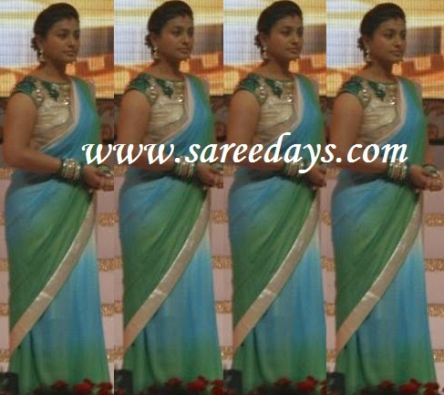Latest saree designs roja in blue and green georgette saree checkout roja in blue and green georgette saree with silver appliqued border and paired with mega short sleeves work blouse with wide open neck pattern altavistaventures Images