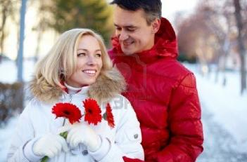 5 Tips for Making Your Relationships Sacred  - woman holding flowers roses - happy-man-and-woman-outdoor-in-winter