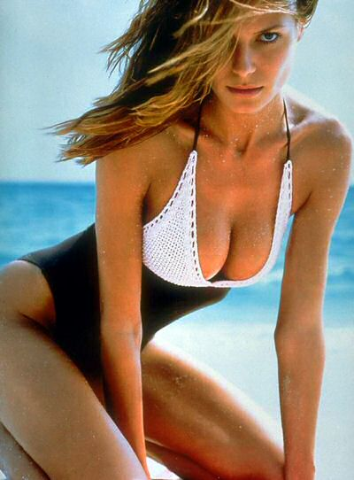 Heidi Klum modelling one piece swimsuits for women for Sports Illustrated Magazine