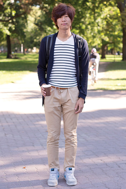 University of Toronto student wears a blue stripe white nautical tee t-shirt under a blue cardigan and over khaki pants and nike sneakers