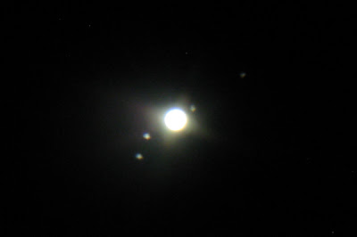 Jupiter and Galilean moons through telescope