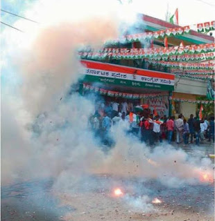 Karnataka Congress workers celebrate their party's victory in the recently held Assembly elections, in Bengaluru