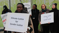 "Activists with signs: ""Climate Justice for Gender Justice"" (Credit: Takver) Click to Enlarge."
