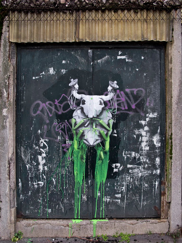 """The Host"" a new street art piece by French artist Ludo on the streets of Paris, France."