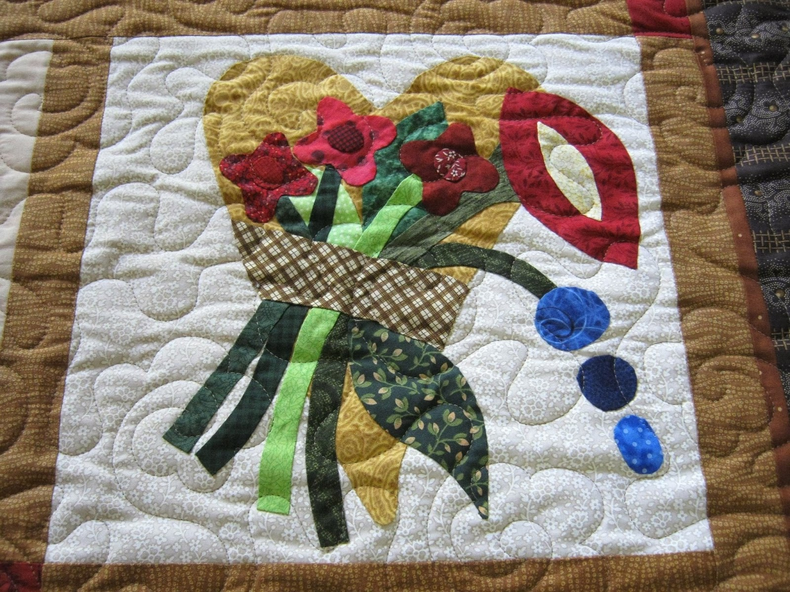 Laugh yourself into stitches: machine quilting over applique