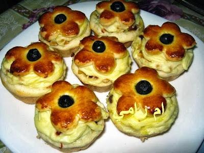 خبزات باللحم والكريمة  13402839471