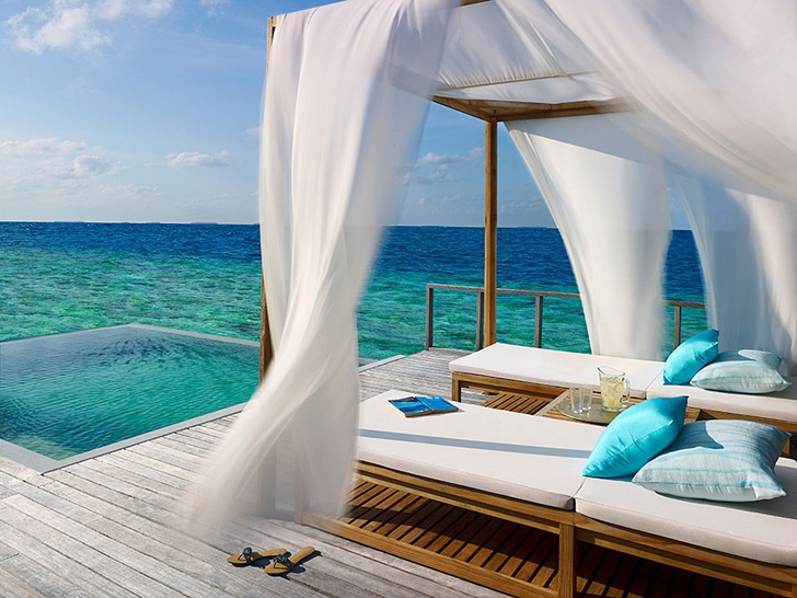 Wooden beds in Luxury Dusit Thani Resort in Maldives