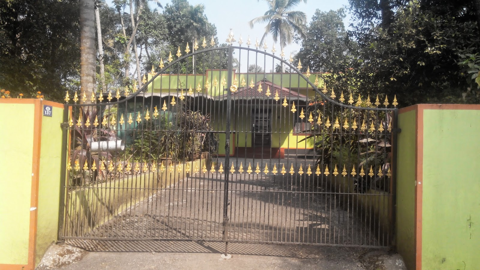 Kerala gate designs front gates of kerala houses for Home gate design