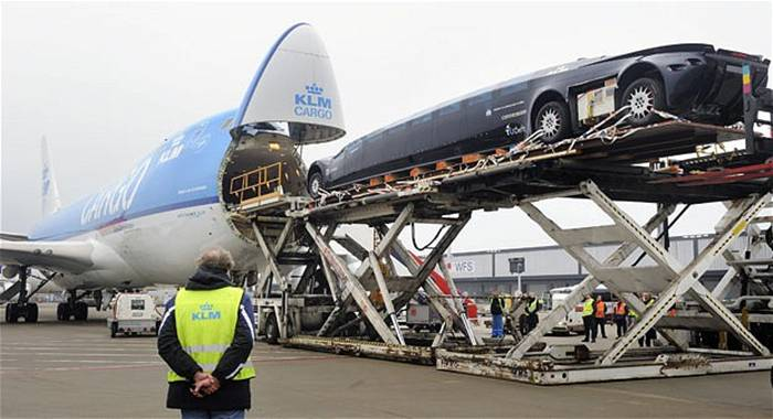 The first Superbus prototype, designed by former astronaut Wubbo Ockels and his team, is loaded into a KLM cargo plane at Schiphol airport, Amsterdam. The Superbus prototype will be presented in Dubai at the International Association of Public Transport exhibition. The electric Superbus is said to reach a speed of up to 250 kilometres per hour with up to 23 people on board.