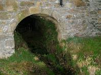 Entrada al carcabà de l'antic molí