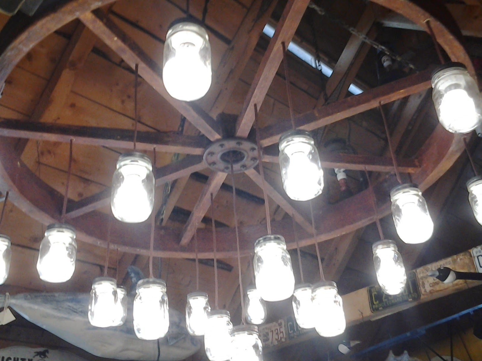 Backroad folkart by kerras jeffery chandelier made from horse i had this 5 0 wide flywheel that came from and old horse powered farming treadmill and made it into a rustic chandelier aloadofball Image collections
