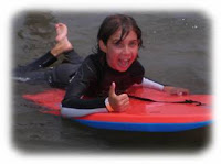 Kid on a boogie board at Aloha Beach Camp Summer Camp Los Angeles.