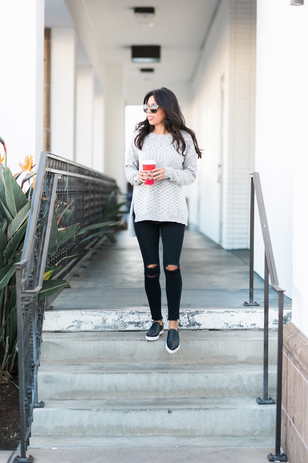 how to wear slip-ons, j brand distressed jeans, how to wear oversized sweater,