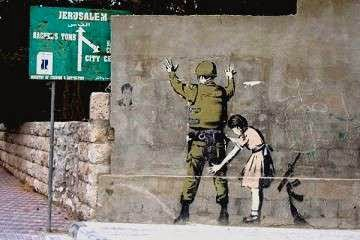 Banksy mural of girl searching Israeli soldier