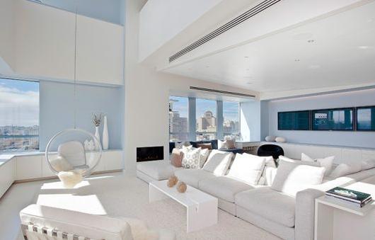 living room with three screen tv ritz carlton penthouse apartment