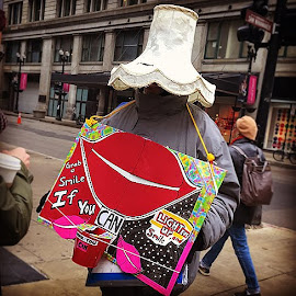 Smile vendor. Hard to keep a straight face after seeing his wide-brimmed lampshade hat.