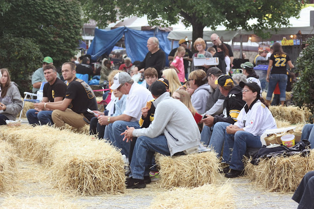 People chatting on hay bales