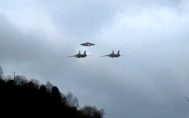 Two Military Jets Escorting UFO To Secret Base!