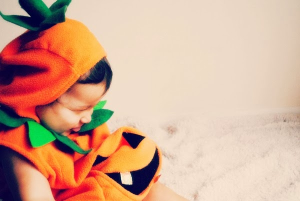 Laughing baby in costume