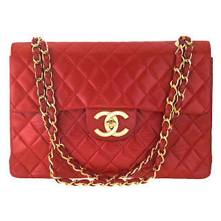 Vintage 1990's red quilted leather Chanel bag with gold hardware.