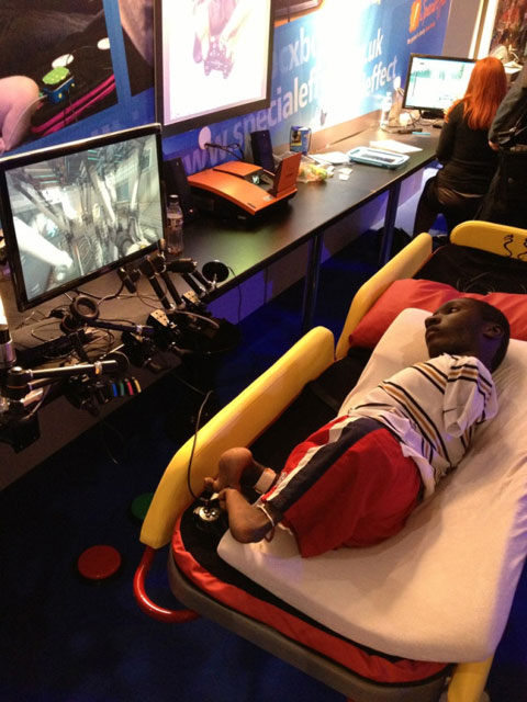 Isaac playing Portal using his feet and a standard Dual-Shock.