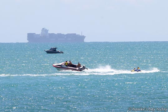 Container ship, pleasure boats, speed boat towing a biscuit, pictured from Hardinge Rd, Napier in the hot sunny weather. photograph