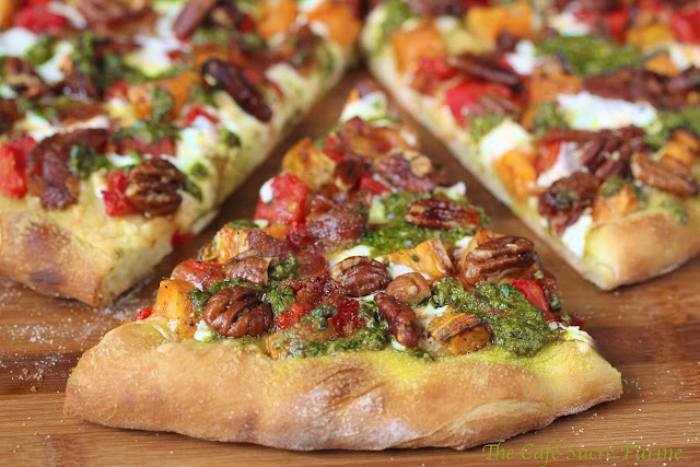 Sweet Potato and Pesto Pizza with Rosemary Braised Bacon - a unique and beautiful pizza with a delicious combination of ingredients. A real crowd pleaser!